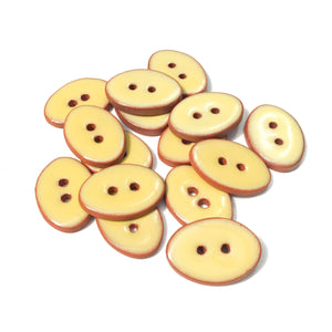 "Yellow Oval Clay Buttons on Terracotta - 5/8"" x 7/8"""