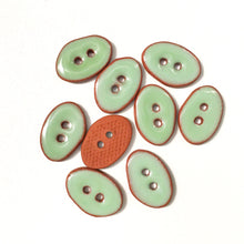 "Load image into Gallery viewer, Light Green Oval Clay Buttons on Terracotta - 1/2"" x 3/4"""