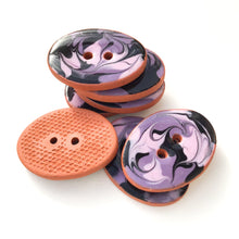 "Load image into Gallery viewer, Black & Purple Swirl Ceramic Buttons on Terracotta Clay - 5/8"" x 7/8"" - 7 Pack"
