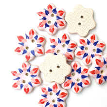Load image into Gallery viewer, Soft Pink Flower Buttons with Red, Coral, & Blue Detail - Ceramic Flower Buttons - 1""