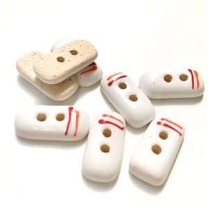 "Rectangular White Ceramic Buttons with Orange + Red Lines - White Clay Buttons - 3/8"" x 3/4"" - 8 Pack"