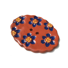 "Load image into Gallery viewer, Scalloped Oval Button with Dark Blue Flowers - 1 1/4"" x 1 3/4"""