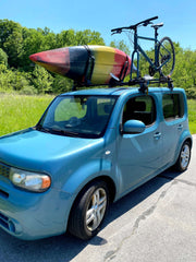 My car with a boat and bike on the roof