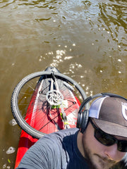 bike tire strapped to the boat