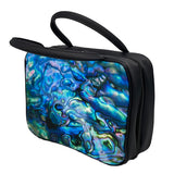 A rectangular vanity/cosmetic case with 2 black handles. The front and back of the cosmetic case display the inside of the iconic Kiwi Pāua shell with beautiful swirls of blue, green and purple. The sides are black, with a black zip around 3 sides.