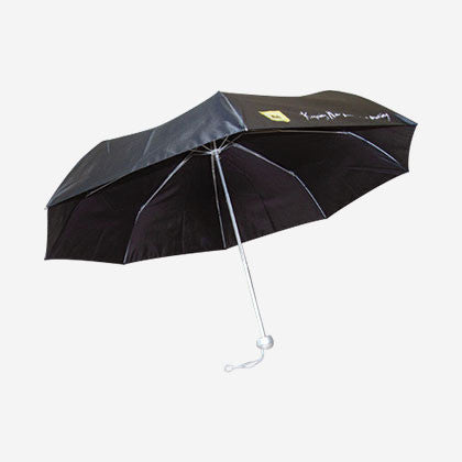 "Black compact umbrella features the yellow AA logo and white text ""Keeping New Zealand moving"""