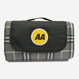 AA Picnic Rug – grey, white and black tartan design; black velcro flap with AA logo; black carry handle; convenient size when folded to store in the boot of your car.