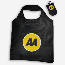 A reusable shopping bag with 2 handles. The bag is black with the yellow and black AA logo. The bag folds down to fit inside a pouch with dome closure and a black plastic clip. The pouch is also black with the AA logo on it.
