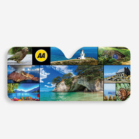 AA Traveller Windscreen Sunshade features a montage of NZ images including Kea, Whakaari White Island, Lake Tekapo and the Church of the Good Shepherd, Cape Reinga lighthouse, Cathedral Cover, Hobbiton, Sheep and Ferns. Also features yellow AA logo on black background. The sunshade is shaped to fit windscreens and to fit around your rearview mirror.