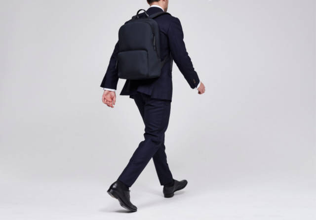 Wearing suit and Troubadour rucksack