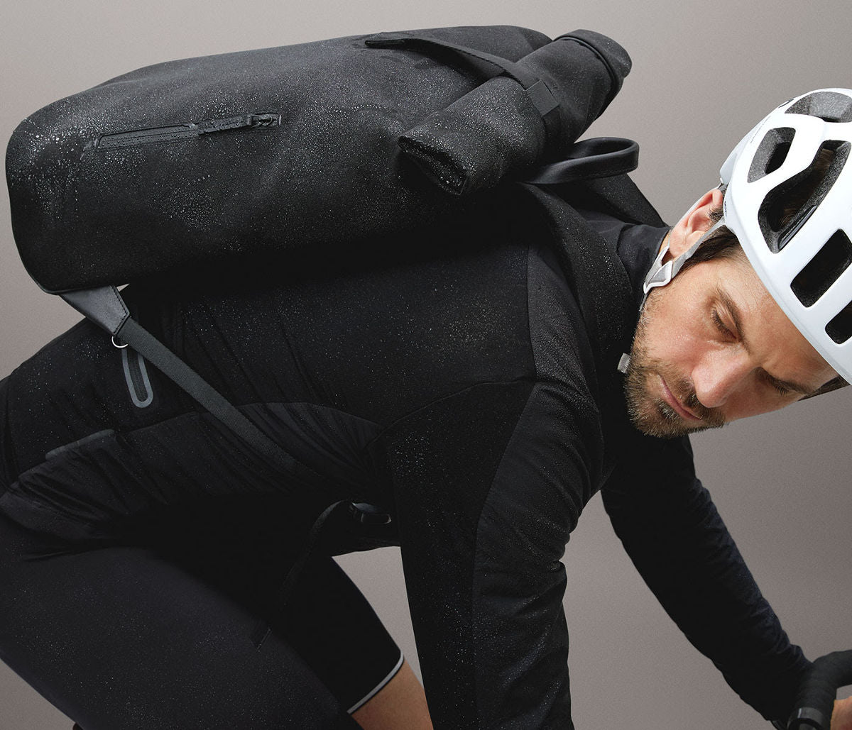 Cyclist wearing black rolltop rucksack