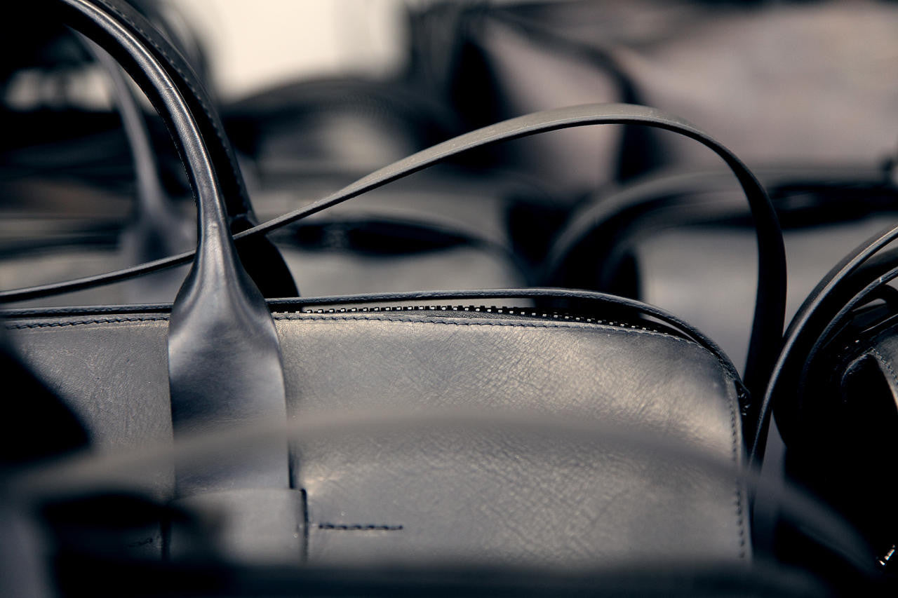 Luxurious black leather on men's day bag