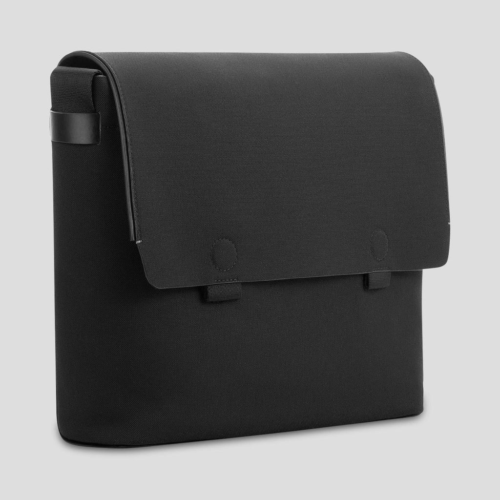 Minimal, clean, high-end black leather messenger bag for men
