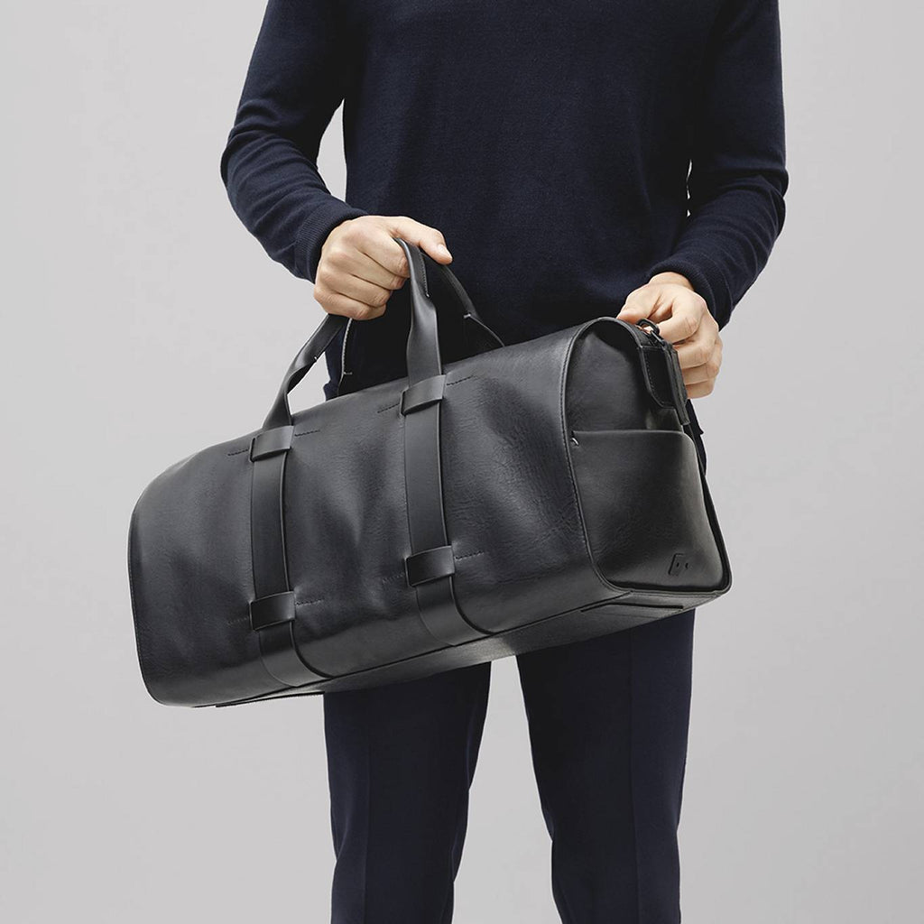 Men's luxury, minimal leather day bag in black
