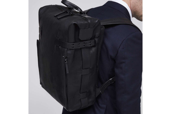 Leather rucksack and suit, closeup