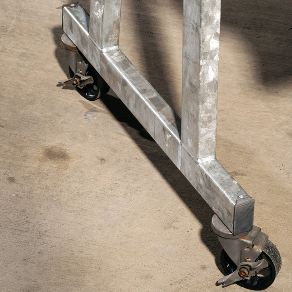 Detailed picture of the galvanized frame and the heavy duty casters that make Blue Streak mobile.  Galvanized/Wenge Sawcut finish.