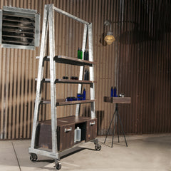 Fast Rattler is an American Industrial style double sided retail shelving, storage and display unit.  Shown in a rustic salon with a Rip Rap retail table.  Galvanized frame and Wenge Saw Cut finish.