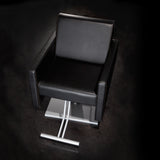 Cutter salon chair shown in black upholstery with a silver square pump base.