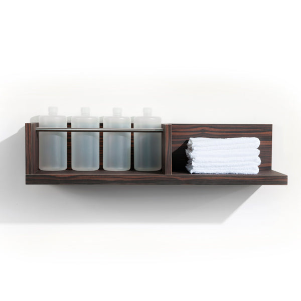 Two Fold is a dual function product dispense and towel shelf for the back bar. It features a laminate clad wood shelf for dry towels and a stainless steel bar retainer for liter bottles. Shown in Jurassic Ebony.