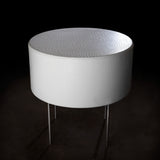 Cylindrical upholstered retail table.  Shown in white synthetic leather with contrasting silver legs.
