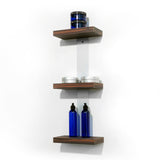 Plank is a wall mounted three product shelf unit with laminate clad wood shelves. Showcase, promote and sell salon product from your stylist stations. Shown in Jurassic Ebony.