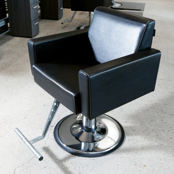 Club is a high end fully upholstered lounge type styling chair constructed in hard wood ply for durability.  All cushions are high resilient foam with a heavy saddle stitched synthetic rawhide leather cover. Shown in black upholstery with chrome and a round base.