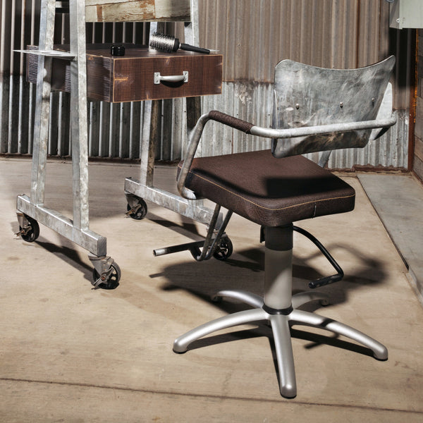 Bobtail styling chair shown in Galvanized and Chocolate finish with a Bluestreak two sided stylist station.