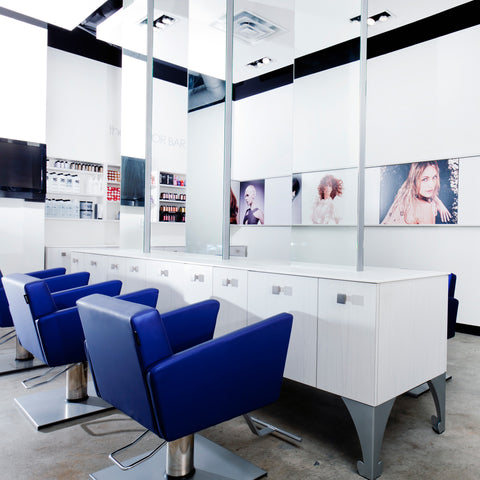 Bureaux is a striking two styling station combo. Shown in White/Silver finish and in a 3 in a row configuration.