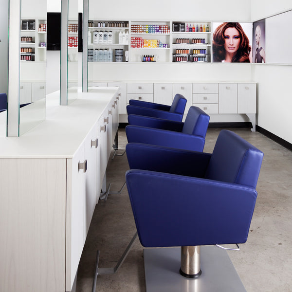 Counter top is an easy to clean and recondition solid surface material. A laminate clad cabinet w/drawer and stainless tool holder provide storage. Stations can be powered from ceiling or floor.  Shown in a set of three Bureaux stations in white/silver finish and with blue Facet styling chairs.