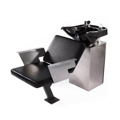 Notch Bak Wash shampoo chair has formed aluminum arms and upholstered cushions stitched and wrapped in faux leather. Adjustable back rest provides a comfortable fit for all. The hand crafted steel base frame is fully welded and finished in powder coat paint. A stainless work top caps the stainless steel sink cabinet.