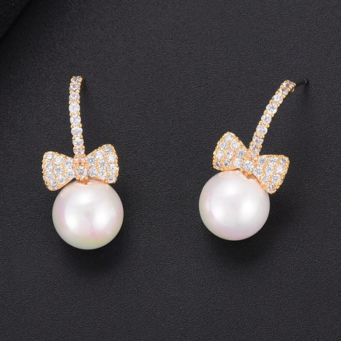 Image of GODKI Fashion Cubic Zirconia Bowknot Imitation Pearl Stud Earrings