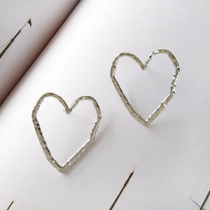 Fashion metal hollow heart stud earrings