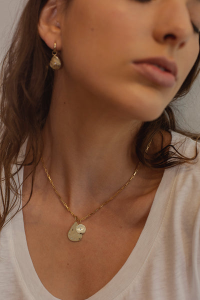 ali grace jewelry handmade in nyc sustainable jewelry gold custom charm evil eye necklace cool girl fine jewelry