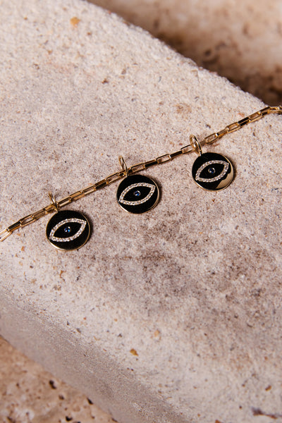 ali grace jewelry sustainable fashion ethical jewelry diamond evil eye charm gold sapphire evil eye fine jewelry necklace