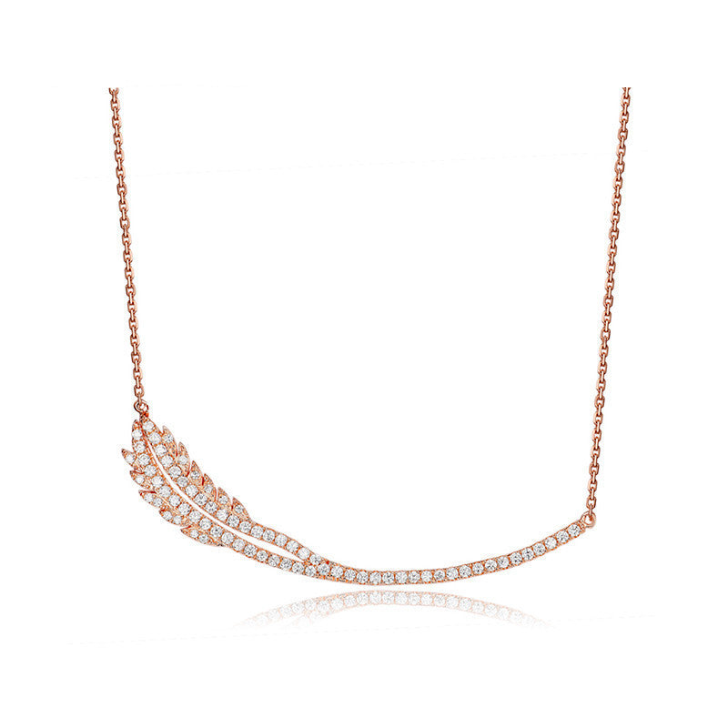 Feather necklace in rose gold - Brownie Sparkles