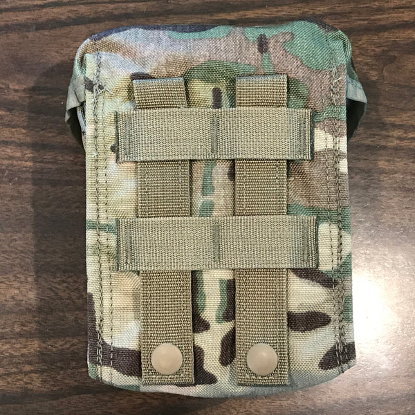 Showing the MOLLE webbing on the back side of the IFAK's Multicam Pouch.