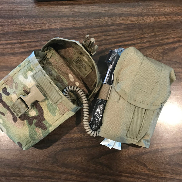 The Improved First Aid Kit holds an organizer insert with the actual contents, tethered to the main Multicam MOLLE Pouch by a lanyard.