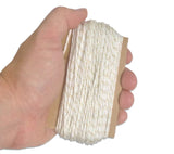 100 ft of natural white Type 1a paracord fits right in the palm of your hand.