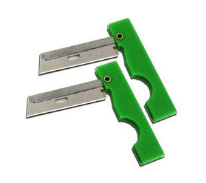 Two green Derma-Safe Razors.