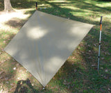 Coyote Brown Tarp Shelter setup with trek poles