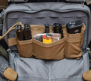 Coyote Brown Hill People Gear 58 Pouch in use, holding survival and shooting gear.
