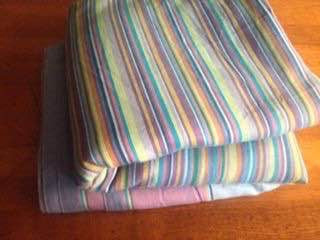 Toto woven wrap, babycarrier. Kikoy made in Kenya. Beautiful shades of purple and blue stripes with dashes of yellow and pink.