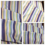 Collage of photos by Toto woven wrap baby carrier Kikoy. A striped beauty of purple, yellow and green.