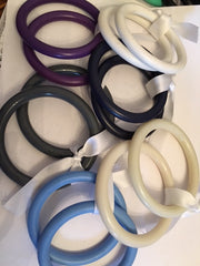 Group shot of 5 different pairs of nylon sling rings. Marsupial Mamas.