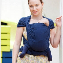 Caregiver carrying baby on front: Natibaby Boston woven wrap, baby carrier. Marsupial Mamas.