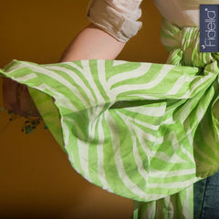 Fidella Shebra Lime, linen. Tail show of woven wrap. Marsupial Mamas.