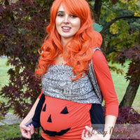 Action shot: Baby Monkey King of Pumpkins Licorice woven wrap baby carrier. Haunted houses, bats, owls, ghosts and more!