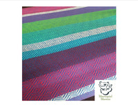 Baby Doo Orchidej woven wrap baby carrier. Vibrant shades of blues, purples and green stripes.
