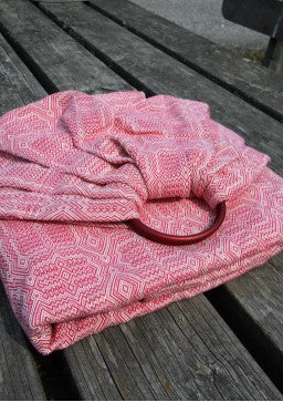 Vanamo Kide Tuli Ring Sling with red rings. Red and white woven design. Marsupial Mamas.