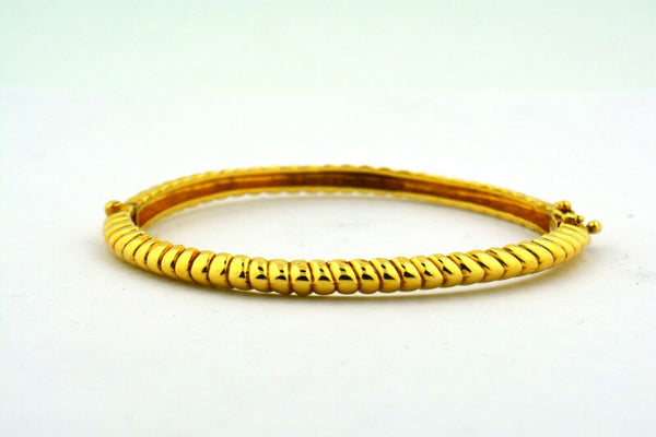 14 Karat Yellow Gold 4.2MM Ribbed Twist Hinged Oval Bracelet 15G - Jewelry Works